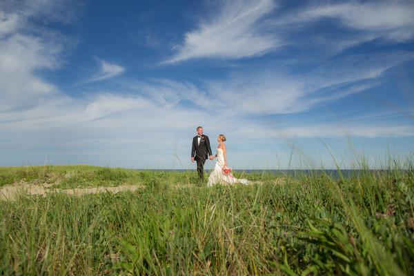 Bride and groom walking on Nantucket Island