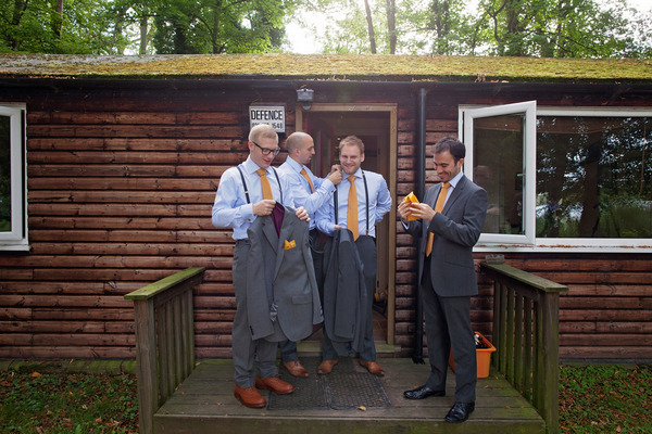 Groomsmen with orange ties