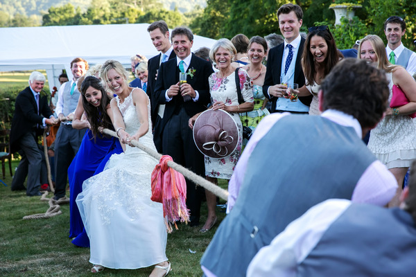 Bride and groom tug of war
