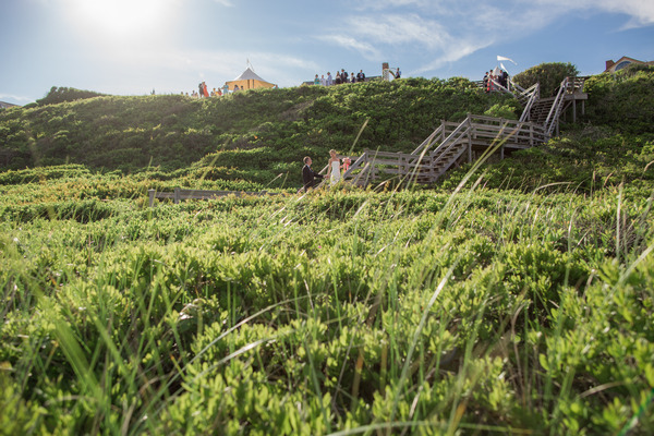 Bridal party walking up steps to reception on Nantucket Island