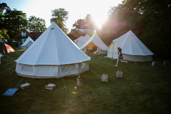 Festival style tipis in garden for wedding