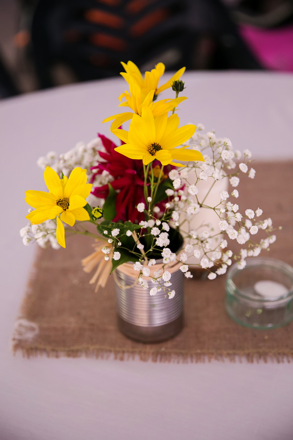 Colourful wedding flowers in can
