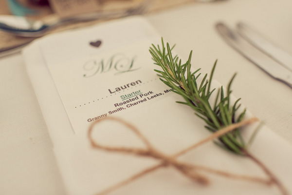 Wedding place setting with rosemary