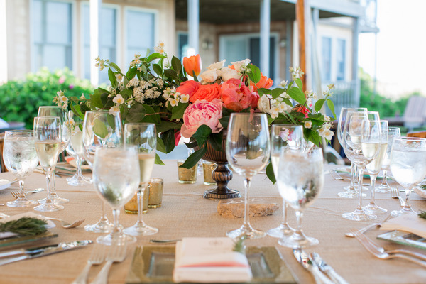 Wedding place setting with bright flowers