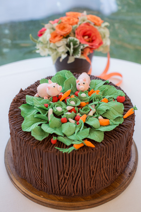 Cake with sugar pigs and vegetable patch