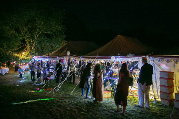 Festival wedding in marquee at night