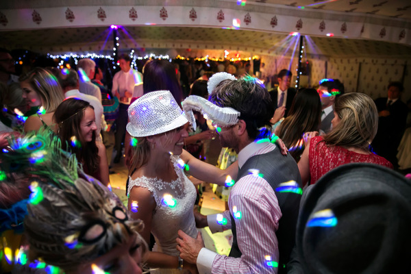 Wedding guests dancing in fancy dress