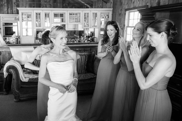 Bridesmaids clapping bride
