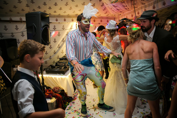 Wedding guest dancing in fancy dress