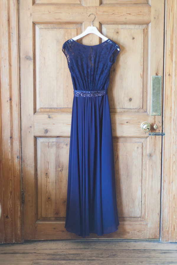 Purple bridesmaid dress hanging on door