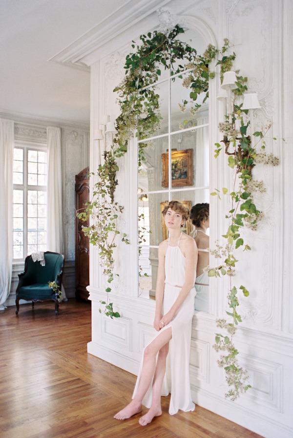 Bride leaning against window effect mirror
