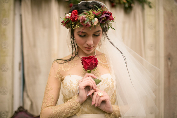 Bride with flower crown holding rose
