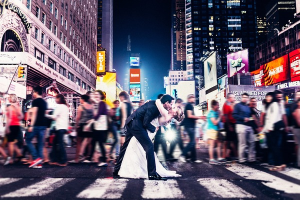 Bride and groom kissing on busy crossing in New York - Picture by Paul Liddement Wedding Stories