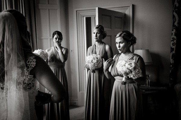 Emotional bridesmaids seeing bride in dress for first time - Picture by Andrew Billington Photography