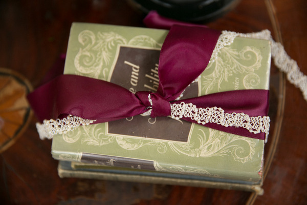 Books with marsala coloured ribbon