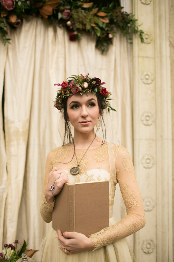 Bride with flower crown holding book