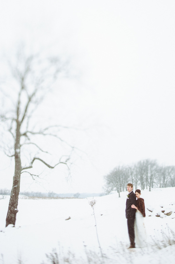 Bride and groom in snow in Wisconsin