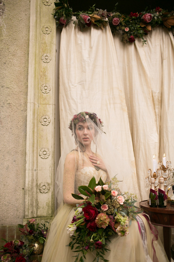 Bride with veil holding large bouquet