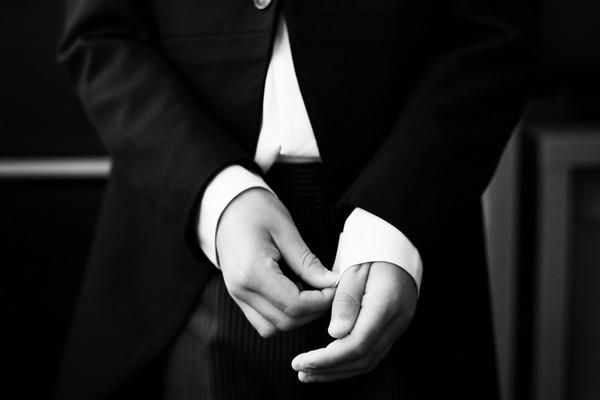Boy pulling down shirt cuffs