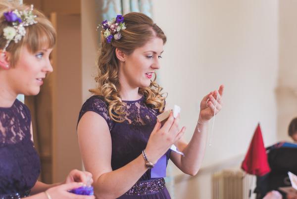 Bridesmaid looking at gift