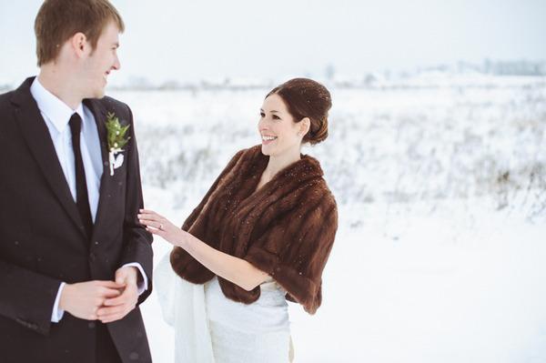 Bride seeing groom in snow