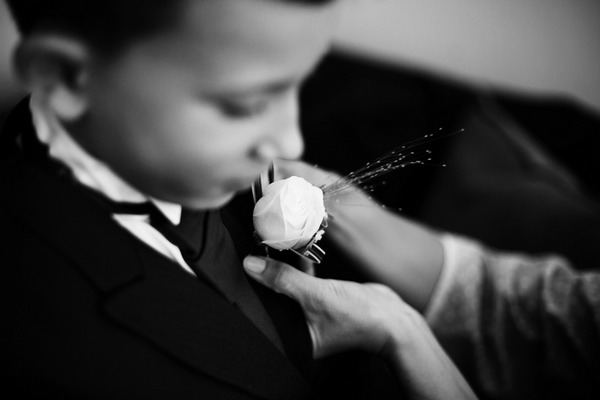 Helping boy with buttonhole