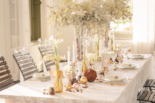 Elegant wedding table with tall flower centrepieces