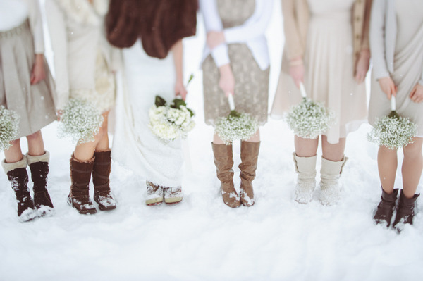 Bride and bridesmaids' legs in snow