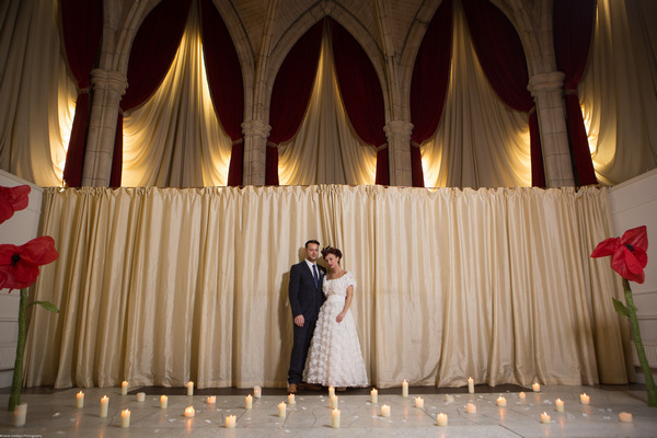Bride and groom in The Great Hall at The Alverton Hotel with cnadles on ground