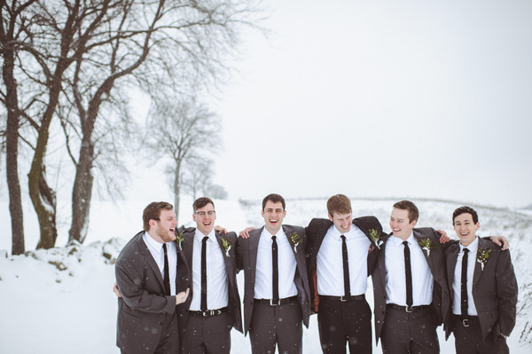 Groomsmen standing in snow