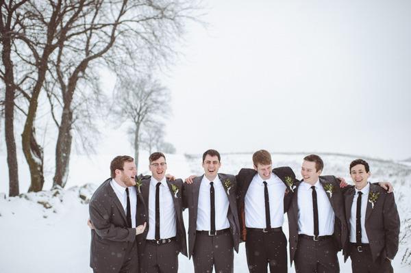 Groomsmen standing in snow
