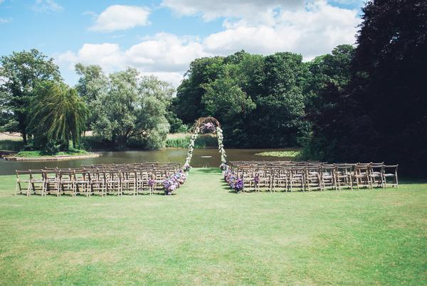 Wedding seating by lake at Narborough Hall Gardens