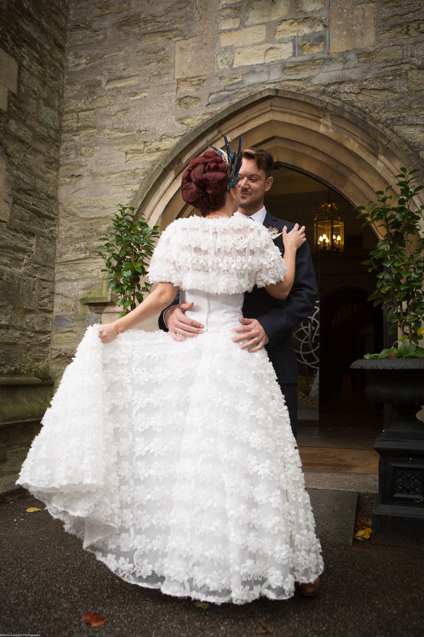 Bride and groom outside The Great Hall at The Alverton Hotel