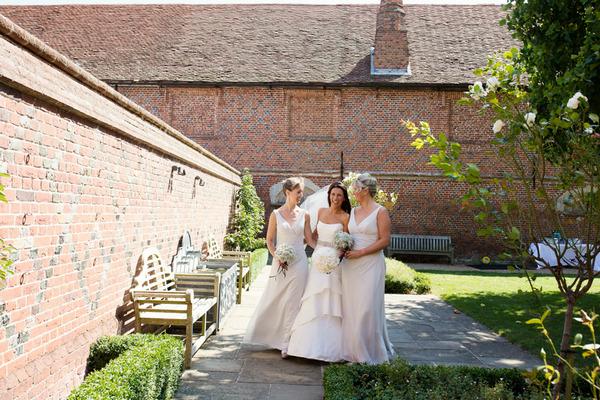 Bride and bridesmaids walking to wedding ceremony
