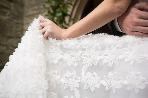 Detail on bride's winter wedding dress