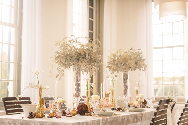 Long wedding table with tall flower centrepieces