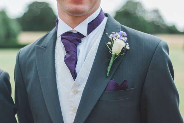 Groom's purple cravat and buttonhole
