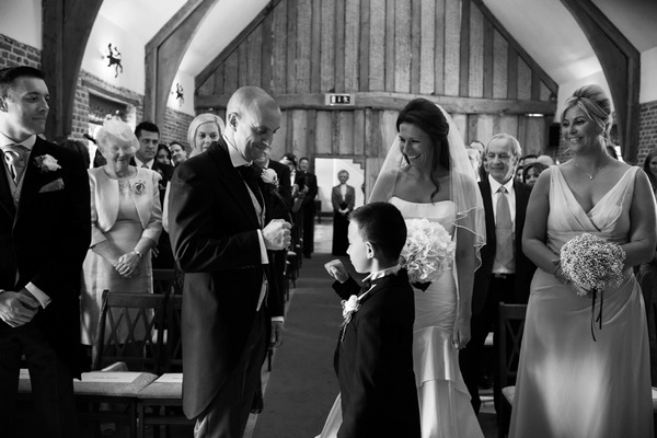 Groom and pageboy doing special handshake