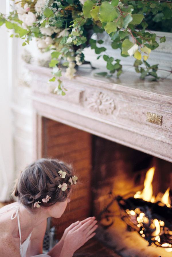 Bride warming hands on fire