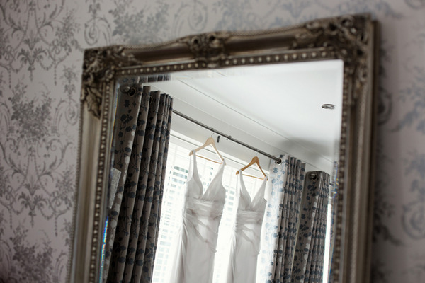 Reflection of white bridesmaid dresses in mirror