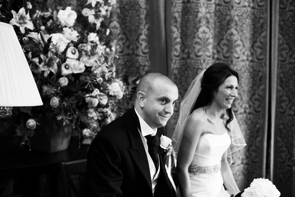 Groom and bride sitting in wedding ceremony