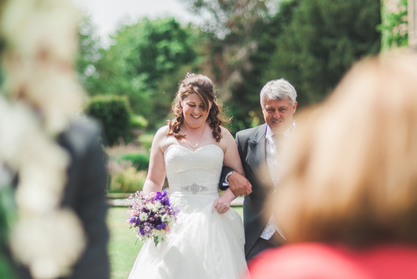 Father walking bride down aisle at Narborough Hall Gardens