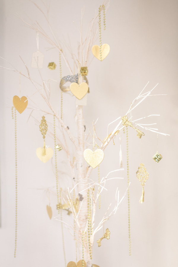 Gold hearts hanging from tree