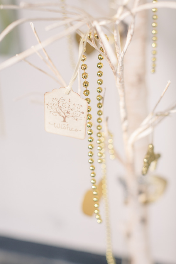 Wishes tag and gold beads on tree