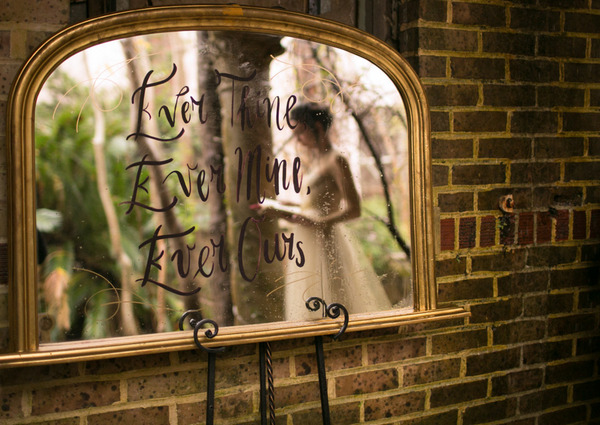 Reflection in mirror of bride reading Beethoven inspired love letter