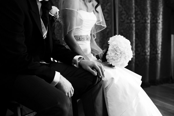 Bride with hand on groom's knee