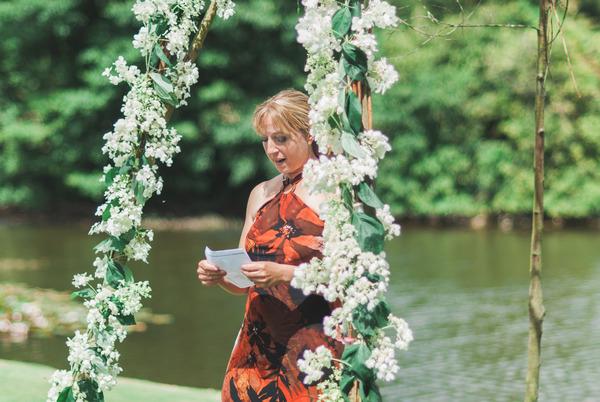 Wedding reading by lake at Narborough Hall Gardens