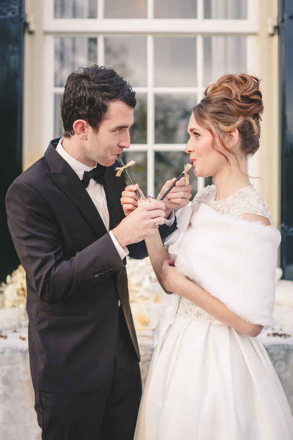 Bride and groom drinking milkshakes