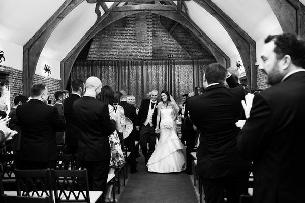 Bride and groom walk back down aisle