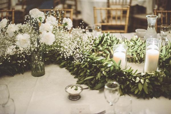Green foliage wedding table centrepiece